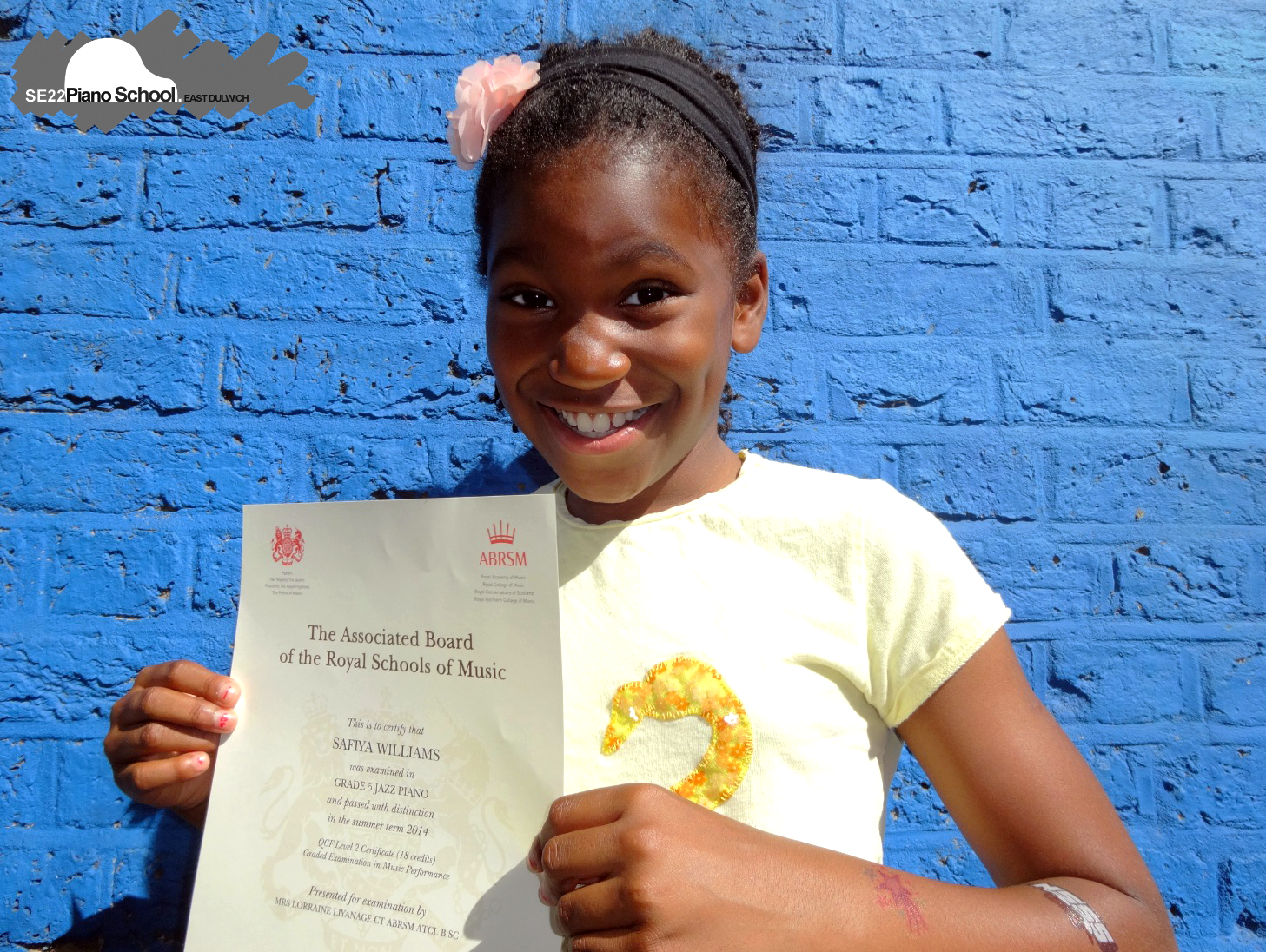 Summer 2014 - Here's Safiya (age 8) with her Grade 5 Distinction Jazz Piano Certificate. Click here to see more of our students' exam results.